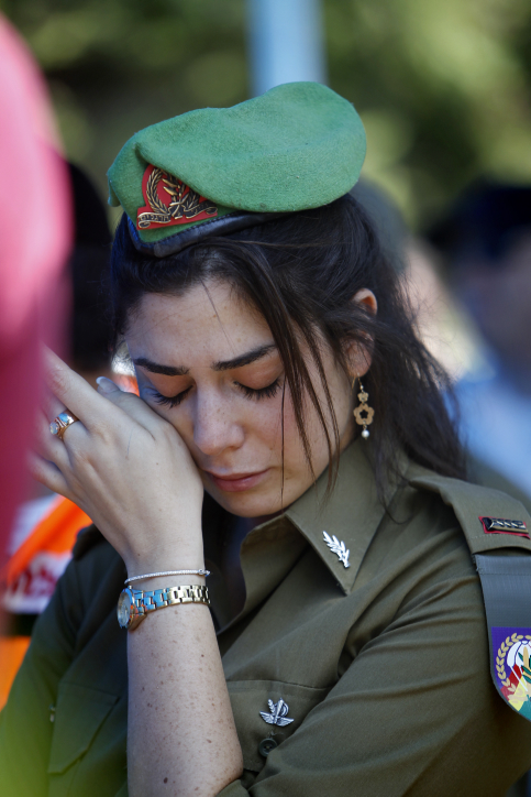 An Israeli soldier cries at the funeral of IDF Maj. Tsafrir Bar Or, at the military cemetery in Holon on July 21, 2014. Bar Or was killed yesterday before dawn during combat in the Gaza Strip. (photo credit: Miriam Alster/FLASH90)