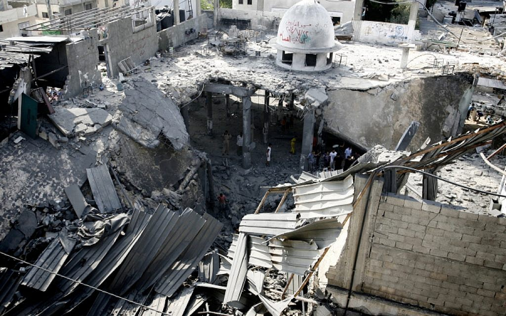 Illustrative. Palestinians inspect the destruction in Farouq Mosque after it was hit in an Israeli airstrike in Rafah, southern Gaza Strip on July 22, 2014. (Abed Rahim Khatib/Flash90)