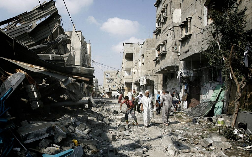 Palestinians inspect the destruction of Farouq Mosque after it was hit in an Israeli airstrike, in Rafah, southern Gaza Strip, on July 22, 2014. (photo credit: Abed Rahim Khatib/Flash90)