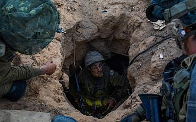Soldiers from the Givati Brigade seen at the entrance to a Hamas attack tunnel on July 23, 2014, during Operation Protective Edge. (Israel Defense Forces/Flash90)
