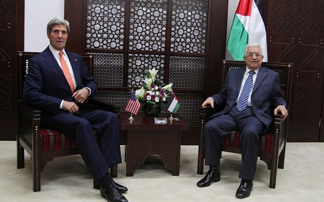US Secretary of State John Kerry (left) speaks with Palestinian Authority President Mahmoud Abbas (right), on Wednesday, July 23, 2014. (photo credit: Issam Rimawi/Flash90)
