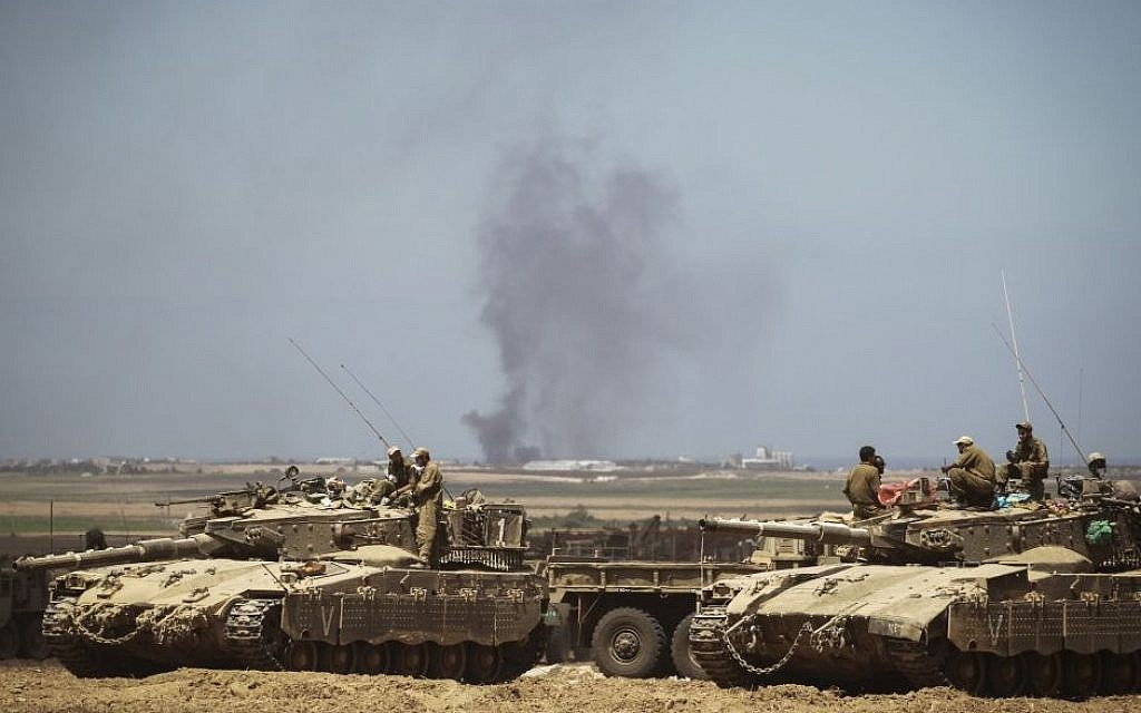 Israeli Air Force bombings in the Gaza Strip can be seen from an IDF deployment in a field near the Israeli border with Gaza on July 25, 2014. (photo credit: Hadas Parush/Flash90)