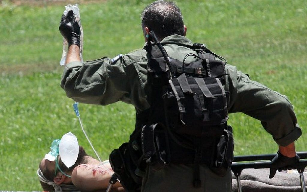 Soldiers wounded in combat in Gaza, are led to the emergency room at Tel Hashomer hospital in Tel Aviv, after being evacuated from the field by helicopter, on July 25, 2014. (Photo credit: Flash90)