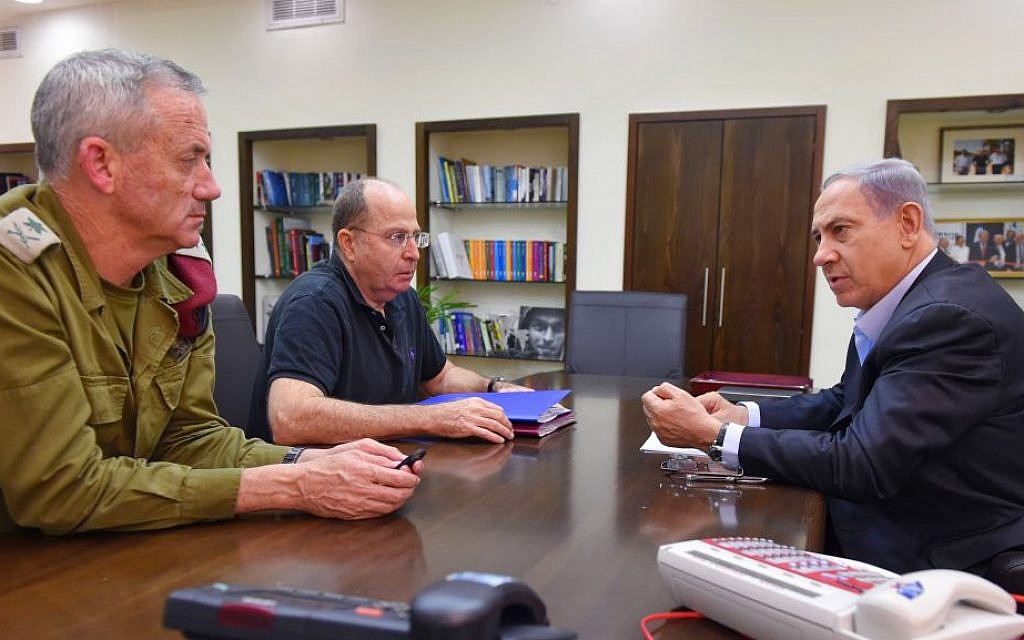 Prime Minister Benjamin Netanyahu (R), Defense Minister Moshe Ya'alon (C), and IDF Chief of Staff, Benny Gantz seen during a meeting at the Kirya military headquarters in Tel Aviv on July 26, 2014. (Photo credit: Ariel Hermoni/Ministry of Defense/Flash90)