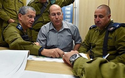 Defense Minister Moshe Ya'alon visits soldiers at an Iron Dome Missile Defense system battery, on July 25, 2014 (Ariel Hermoni/Ministry of Defense/Flash90)