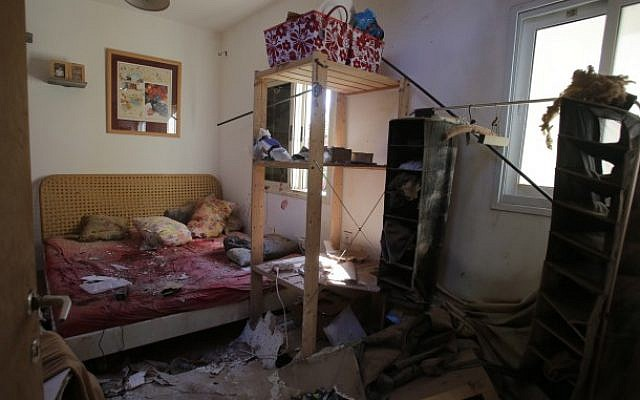 The damage caused to a house after it was hit by a rocket in Nahal Oz, on the border with the Gaza Strip on July 27, 2014, (Photo credit: Edi Israel/Flash90