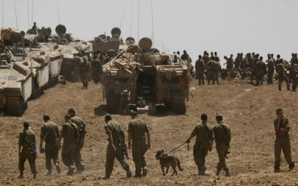 Israeli soldiers seen at an IDF gathering point in a field near the Israeli border with Gaza, July 27, 2014. (photo credit: Miriam Alster/Flash90)