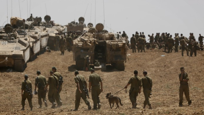 idf launches criminal probes over incidents in gaza war the i iers seen at an idf gathering point in a field near the i border