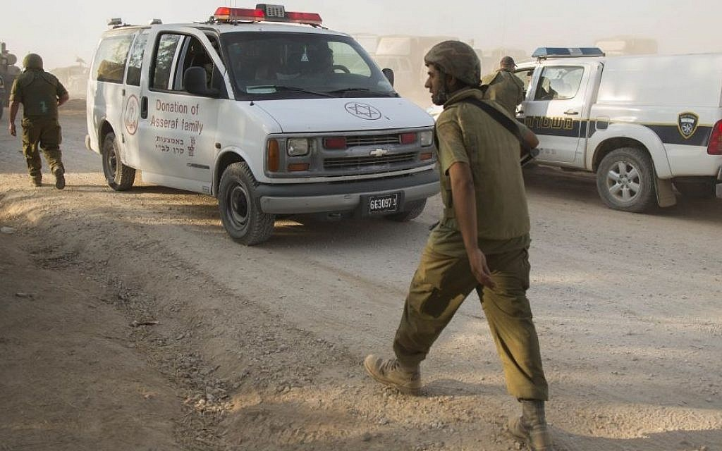 An injured Israeli soldier is evacuated by ambulance from the area near the Israeli border with the Gaza Strip, on July 28, 2014. (photo credit: Yonatan Sindel/Flash90)