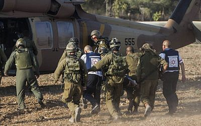 An injured Israeli soldier is evacuated by helicopter from the area close to the Israeli border with the Gaza Strip, July 28, 2014. (photo credit: Yonatan Sindel/Flash90)