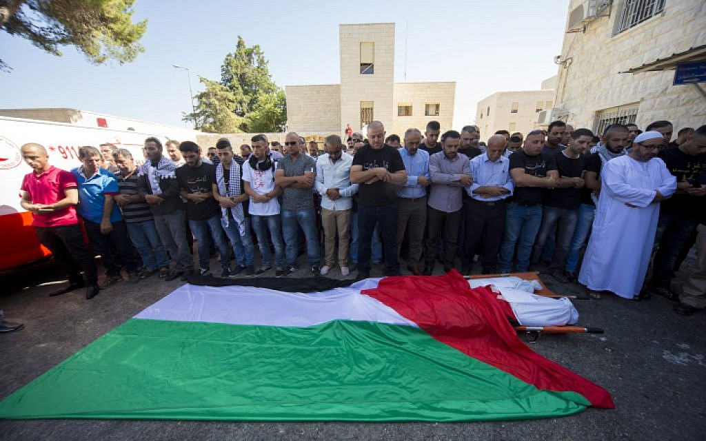 Palestinians mourn Zehir Al-Najar, 7, and Ahmed Abu Baler, 19, from the Gaza Strip, at their funeral in East Jerusalem July 30, after they died from injuries sustained following an Israeli military strike in Khan Yunis, Gaza Strip (photo credit: Sliman Khader/FLASH90)