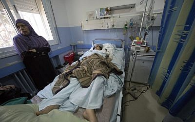 A Palestinian woman from the Gaza Strip injured during an Israeli airstrike in Gaza is treated at the Saint Joseph hospital in East Jerusalem on July 30, 2014. (Sliman Khader/FLASH90)