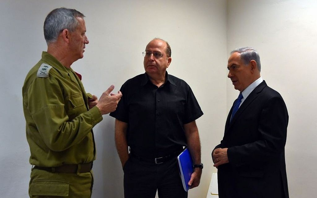 Defense Minister Moshe Ya'alon (center), during the war in Gaza, summer 2014 (photo credit: Ariel Hermoni/Defense Ministry/Flash90)