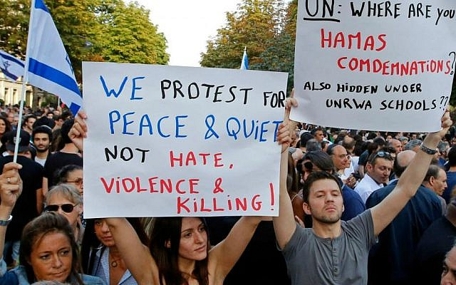 Demonstrators hold pro-Israel placards during a gathering in front of the Israeli Embassy in Paris, France, Thursday, July 31, 2014. (AP Photo/Francois Mori)
