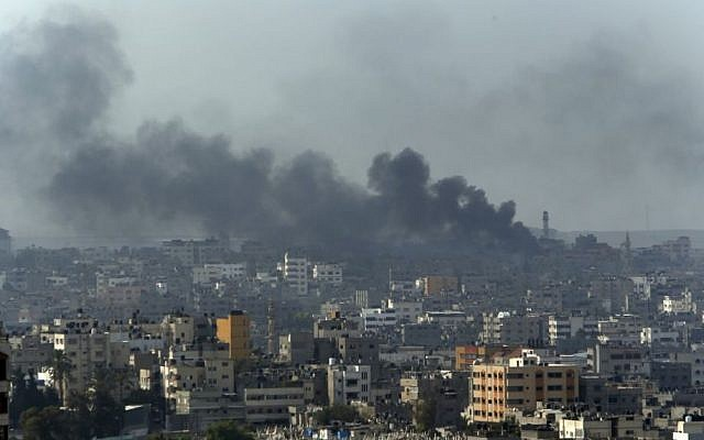Smoke from Israeli strikes rise over Gaza City, northern Gaza Strip, Monday, July 21, 2014. (photo credit: AP Photo/Lefteris Pitarakis)