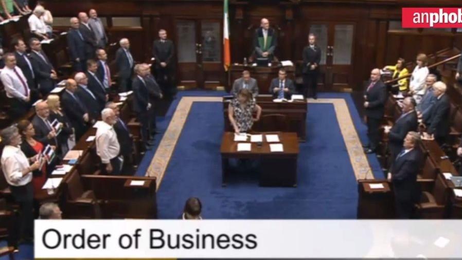 Gerry Adams (bottom left) leads a minute's silence for Gaza in the Irish parliament (Belfast Telegraph screenshot)