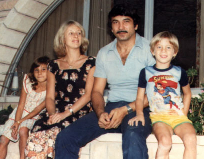Claire Hajaj (left), her mother, father, and younger brother in Kuwait, 1980. (Courtesy)