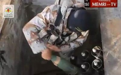 A Gaza terrorist preparing to fire rockets into Israel from an underground launcher. (photo credit: MEMRI)