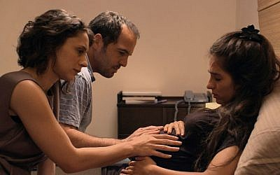 A Tel Aviv couple takes in an expectant mother and her husband from the north during the Second Lebanon War in 'Haven.' (courtesy)