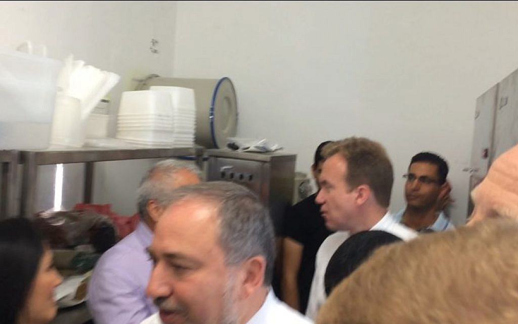 Avigdor Liberman, foreground, and Norwegian Foreign Minister Borge Brende, in white shirt, in an Ashkelon bomb shelter during a rocket attack on Wednesday July 16, 2014. (photo credit: courtesy)