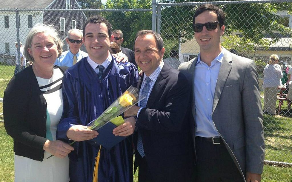 Owen Suskind celebrated his graduation from the Riverview School in Cape Cod, MA in June with his parents and his brother Walter. (Courtesy)