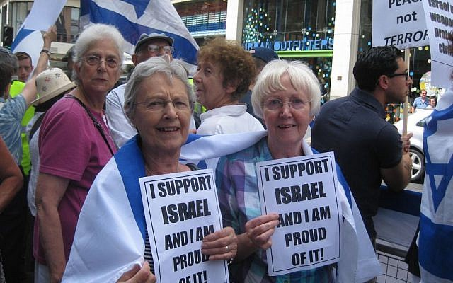 Women hold signs stating 'I support Israel and I am proud of it' at a London rally on Sunday, July 20, 2014 (Jennifer Lipman/The Times of Israel)