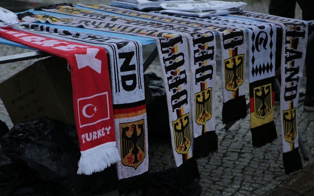 Turkish national team scarf among the World Cup paraphernalia for sale in Berlin, July 13, 2014. (Micki Weinberg/The Times of Israel)