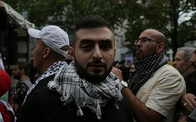 Ahmed E. at the Al Quds Day protest in Berlin, July 25, 2014. Photo credit: Micki Weinberg)