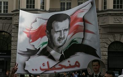 A banner of Syrian President Bashar Assad at an Al Quds Day protest in Berlin, July 25, 2014. Photo credit: Micki Weinberg)