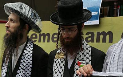 Neturei Karta members attend an Al Quds day demonstration in Berlin, July 25, 2014. (Photo credit: Micki Weinberg)