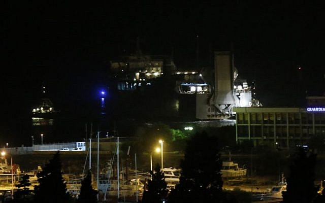 The US cargo vessel MV Cape Ray leaves the Gioia Tauro port, southern Italy, Wednesday, July 2, 2014. Cargo containers carrying hundreds of tons of Syrian chemical weapons were loaded onto a U.S. cargo ship Wednesday for destruction at sea, one of the final phases of the international effort to rid Syria of its chemical weapon stockpile. (Photo credit: AP/Luca Bruno)