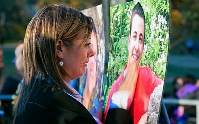 Leehy Shaar in front of a photo of Gil-ad at a June 19, 2014 vigil at Pan Pacific Park in Los Angeles. (Photo credit: Marvin Steindler)