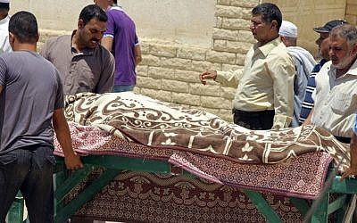 In this file photo taken Monday, July 14, 2014, Egyptians prepare to bury a victim of Sunday mortar fire in el-Arish northern Sinai, Egypt. In the Gaza war, the Palestinian Hamas is demanding the opening of Egypt's Sinai border crossing into blockaded Gaza, but Egypt is so far staunchly refusing _ a reflection of its sharp rivalry with Hamas, which it accuses of fueling militancy on its soil. (Photo credit: AP Photo, File)