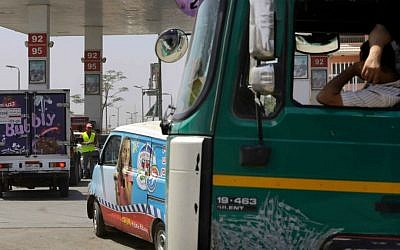 Egyptian drivers wait in line to buy fuel at a gasoline station in Cairo, Egypt, Saturday, July 5, 2014. (AP Photo/Amr Nabil)