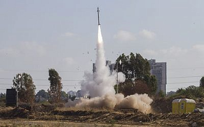 An Iron Dome air defense system fires to intercept a rocket from the Gaza Strip in Tel Aviv, July 9, 2014. (AP/Dan Balilty)