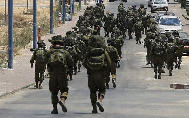 In this Monday, July 21, 2014 file photo, Israeli soldiers patrol the town of Sderot after a group of Hamas terrorists was detected infiltrating into Israel (AP/Tsafrir Abayov)