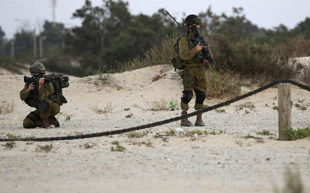 Israeli soldiers patrol along the beach front near the Israel-Gaza border on Wednesday, July 9, 2014. (photo credit: AP Photo/Tsafrir Abayov)