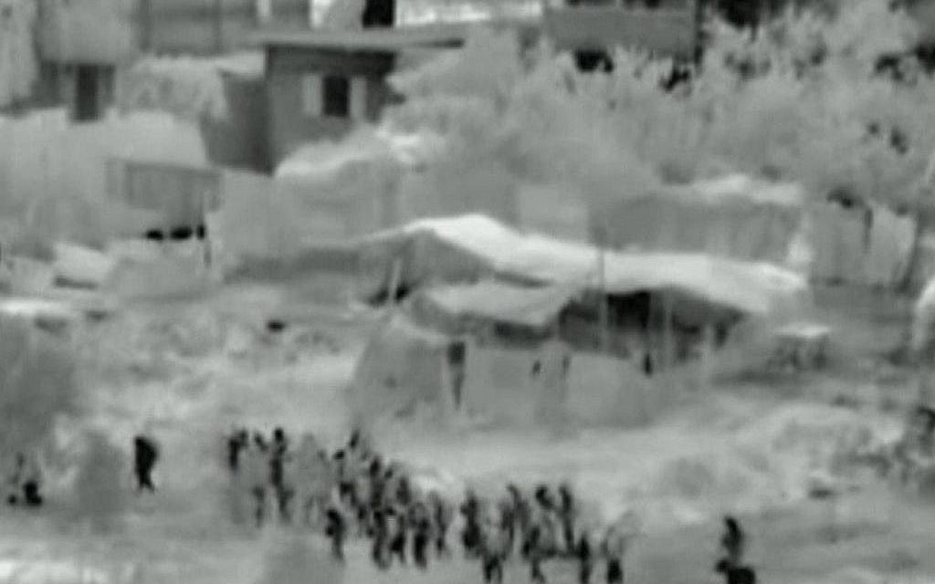 This image made from video released by the Israeli military on Friday, July 18, 2014 shows troops after crossing into the Gaza Strip at the beginning of a ground offensive Thursday, July 17, 2014. Israeli troops pushed deeper into Gaza on Friday to destroy rocket launching sites and tunnels (photo credit: AP Photo/Israeli Defense Forces via AP video)