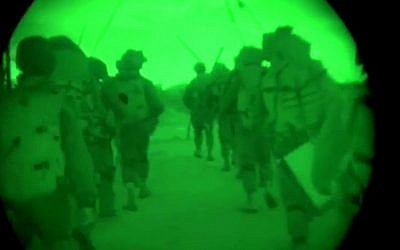 This image made from video shot through a night vision scope released by the Israeli military on Friday, July 18, 2014, shows troops during the early hours of a ground offensive in the Gaza Strip.  (photo credit: AP Photo/Israeli Defense Forces)