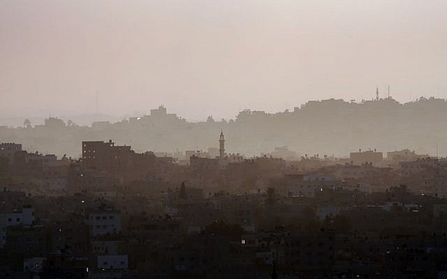 Hazy Gaza City is seen early Saturday, July 19, 2014. Israeli troops pushed deeper into Gaza on Friday in a ground offensive that officials said could last up to two weeks. (photo credit: AP Photo/Lefteris Pitarakis)