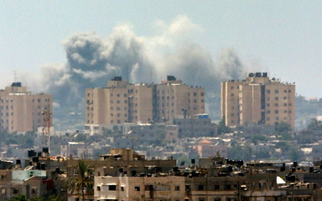 Smoke rises following an Israeli strike on Gaza, seen from the Israel-Gaza Border, Thursday, July 10, 2014. (AP Photo/Lefteris Pitarakis)