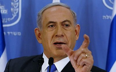 Prime Minister Benjamin Netanyahu during a press conference at the Defense Ministry in Tel Aviv, Friday, July 11, 2014. (photo credit: AP/Gali Tibbon, Pool)
