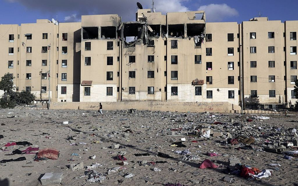 Debris lies scattered at the scene of a damaged apartment block after it was hit by an Israeli airstrike in Beit Lahiya, northern Gaza Strip on Tuesday, July 15, 2014. (photo credit: AP/Adel Hana)