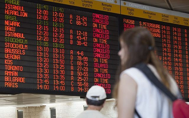 A departure flight board displays various canceled and delayed flights in Ben-Gurion International Airport on Wednesday, July 23, 2014.  (photo credit: AP/Dan Balilty)