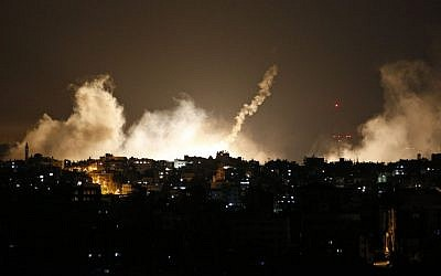 Smoke from flares rises in the sky in Gaza City, in the northern Gaza Strip, overnight Thursday-Friday, July 17-18, 2014. (photo credit: AP/Lefteris Pitarakis)