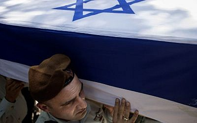 Israeli soldiers carry the coffin of Maj. Tzafrir Bar-Or, 32, one of 13 soldiers who were killed in several separate incidents in Shejaiya on Sunday, July 20, 2014, at the military cemetery in Holon, Monday, July 21, 2014. . (Photo credit: AP/Dan Balilty)
