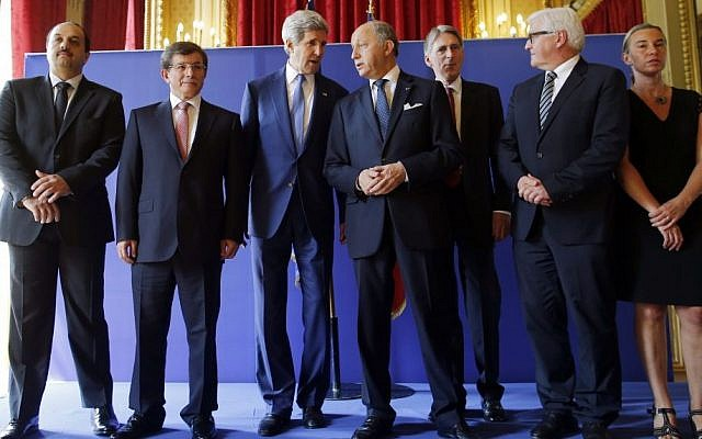 US Secretary of State John Kerry, third from left, stands with from left, Qatari Foreign Minister Khaled al-Attiyah, Turkish Foreign Minister Ahmet Davutoglu, French Foreign Minister Laurent Fabius, British Foreign Secretary Philip Hammond, German Foreign Minister Frank-Walter Steinmeier and Italian Foreign Minister Federica Mogherini after their meeting regarding a cease-fire between Hamas and Israel in Gaza, Saturday, July 26, 2014, at the foreign ministry in Paris, France. (photo credit: AP/Charles Dharapak)