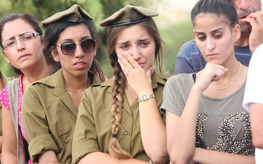 An Israeli soldier cries at the funeral of Israeli soldier Sgt. Adar Bersano, a 20-year-old killed fighting a group of Hamas terrorists who infiltrated Israel through a tunnel from the center of the Gaza Strip, at his funeral in the town of Nahariya, on July 20, 2014. (photo credit: FLASH90)