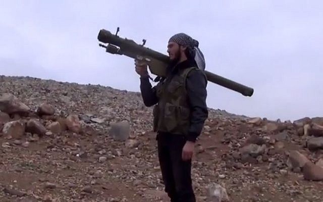 Screen capture from a video allegedly showing a Syrian rebel with an SA-7 anti-aircraft missile. (screen capture: YouTube/gresh775)