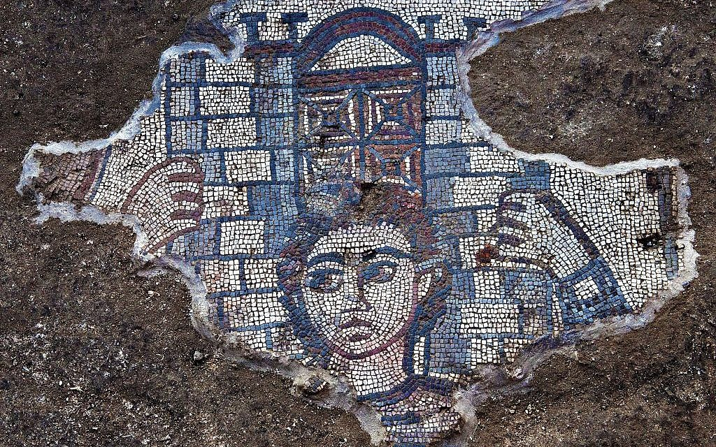 Detail from the Huqoq synagogue's 5th century mosaic showing Samson carrying the gate of Gaza, from Judges 16. (photo credit: Jim Haberman)